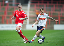 WREXHAM, WALES - Monday, May 7, 2012: Wrexham's Mark Creighton in action against Luton Town's Alex Lawless during the Football Conference Premier Division Promotion Play-Off 2nd Leg at the Racecourse Ground. (Pic by David Rawcliffe/Propaganda)