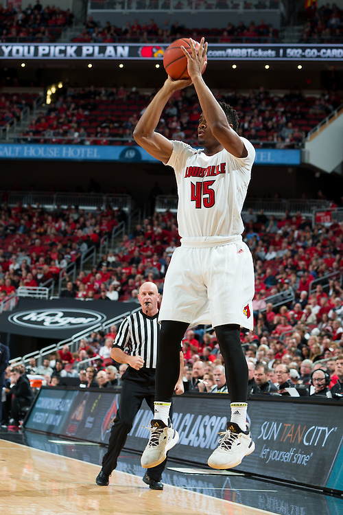 Louisville guard Donovan Mitchell shoots a three point basket in the second half. The University of Louisville hosted Eastern Kentucky University, Saturday, Dec. 17, 2016 at The KFC Yum Center in Louisville. Louisville won 87-56.
