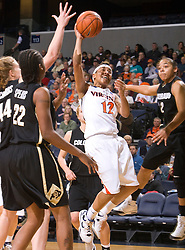 Virginia guard Britnee Millner (12) shoots over Colorado center Kara Richards (44).  The #16 ranked Virginia Cavaliers women's basketball team defeated the Colorado Buffaloes 77-43 at the John Paul Jones Arena on the Grounds of the University of Virginia in Charlottesville, VA on November 24, 2008.
