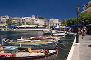 Colurful small fishing boats and tavernas surrounding Lake Voulismeni (the bottomless lake) in Agios Nikolaos, Crete
