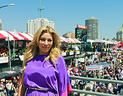 LONG BEACH, CA - 04/15/2012: American pop singer-songwriter and actress Taylor Dayne wears a purple dress with black high heels as she sings the US National Athem at the 2012 Toyota Grand Prix of Long Beach, CA. 15th April 2012. Byline, credit, TV usage, web usage or linkback must read SILVEX.PHOTOSHELTER.COM Photo by Eduardo E. Silva