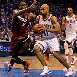 Jun 12, 2012; Oklahoma City, OK, USA; Oklahoma City Thunder point guard Derek Fisher (37) drives past Miami Heat shooting guard Dwyane Wade (3) during the third quarter of game one in the 2012 NBA Finals at the Chesapeake Energy Arena.  Mandatory Credit: Derick E. Hingle-US PRESSWIRE