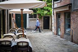 Walking the dog, early morning in Dosoduro, Venice, Italy.<br /> Photo: Ed Maynard<br /> 07976 239803<br /> www.edmaynard.com