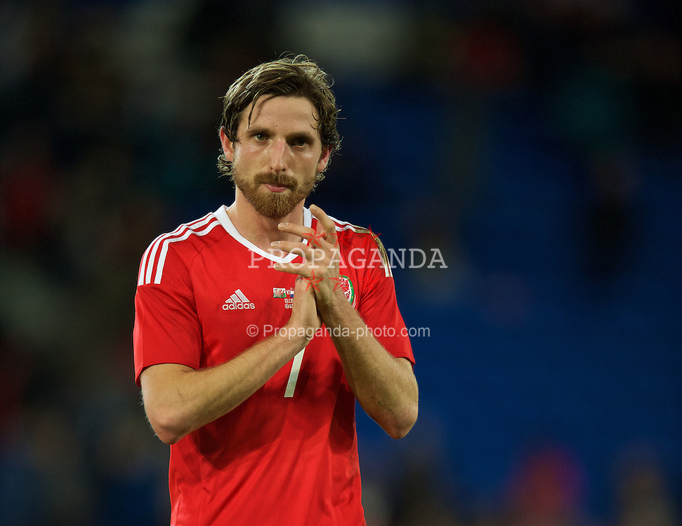 CARDIFF, WALES - Friday, November 13, 2015: Wales' Joe Allen applauds the supporters after the 3-2 defeat to the Netherlands during the International Friendly match at the Cardiff City Stadium. (Pic by David Rawcliffe/Propaganda)