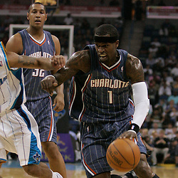 Apr 07, 2010; New Orleans, LA, USA; Charlotte Bobcats guard Stephen Jackson (1) drives past New Orleans Hornets guard Marcus Thornton (5)during the first half at the New Orleans Arena. Mandatory Credit: Derick E. Hingle-US PRESSWIRE