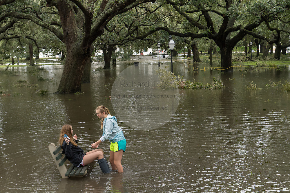 Young girls surrounded by flood water in White Point Gardens in historic downtown after Hurricane Matthew passed through causing flooding and light damage to the area October 8, 2016 in Charleston, South Carolina. The hurricane made landfall near Charleston as a Category 2 storm but quickly diminished as it moved north.