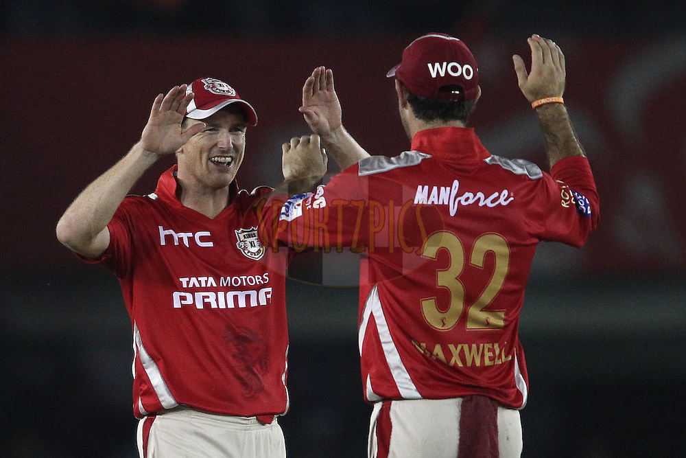 Karanveer Singh of Kings XI Punjab and Kings XI Punjab captain George Bailey celebrate as Kings XI Punjab beat Royal Challengers Bangalore during match 50 of the Pepsi IPL 2015 (Indian Premier League) between The Kings XI Punjab and The Royal Challengers Bangalore held at the Punjab Cricket Association Stadium in Mohali, India on the 13th May 2015.<br /> <br /> Photo by:  Shaun Roy / SPORTZPICS / IPL