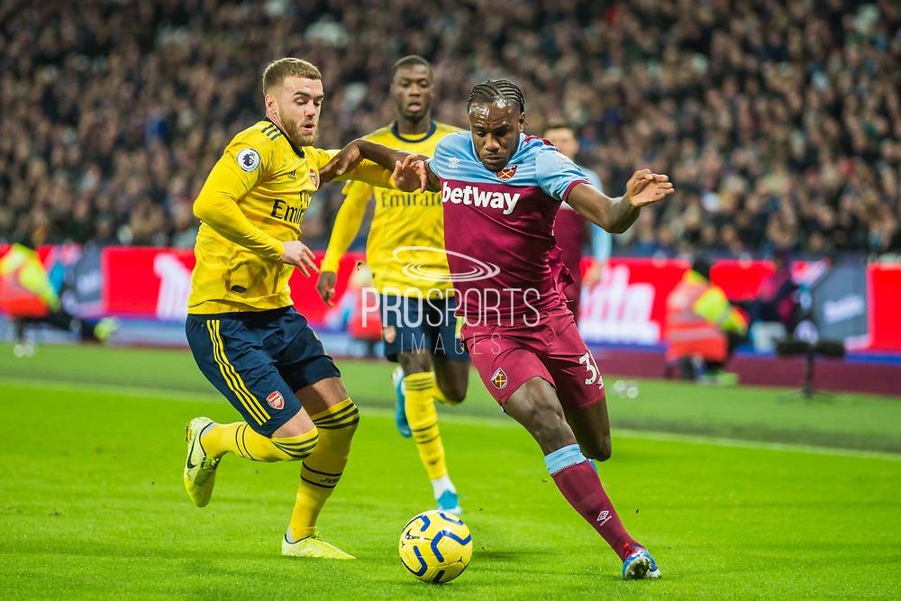 Michail Antonio (West Ham) getting the ball past Calum Chambers (Arsenal) during the Premier League match between West Ham United and Arsenal at the London Stadium, London, England on 9 December 2019.