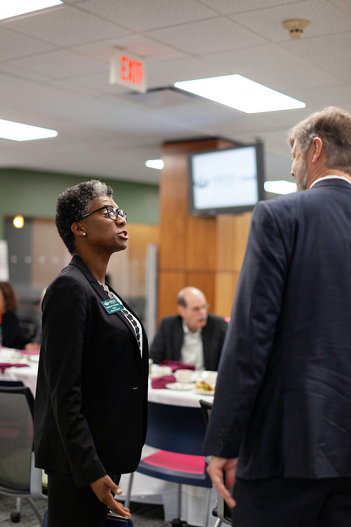 Janelle N. Coleman, Board of Trustees vice chair, and Dave Moore, professor of educational studies, enjoy lunch and conversation at the grand opening and ribbon cutting for the new CoLab, October 18, 2018. (Photo by Stephen Zenner/Ohio University Libraries)