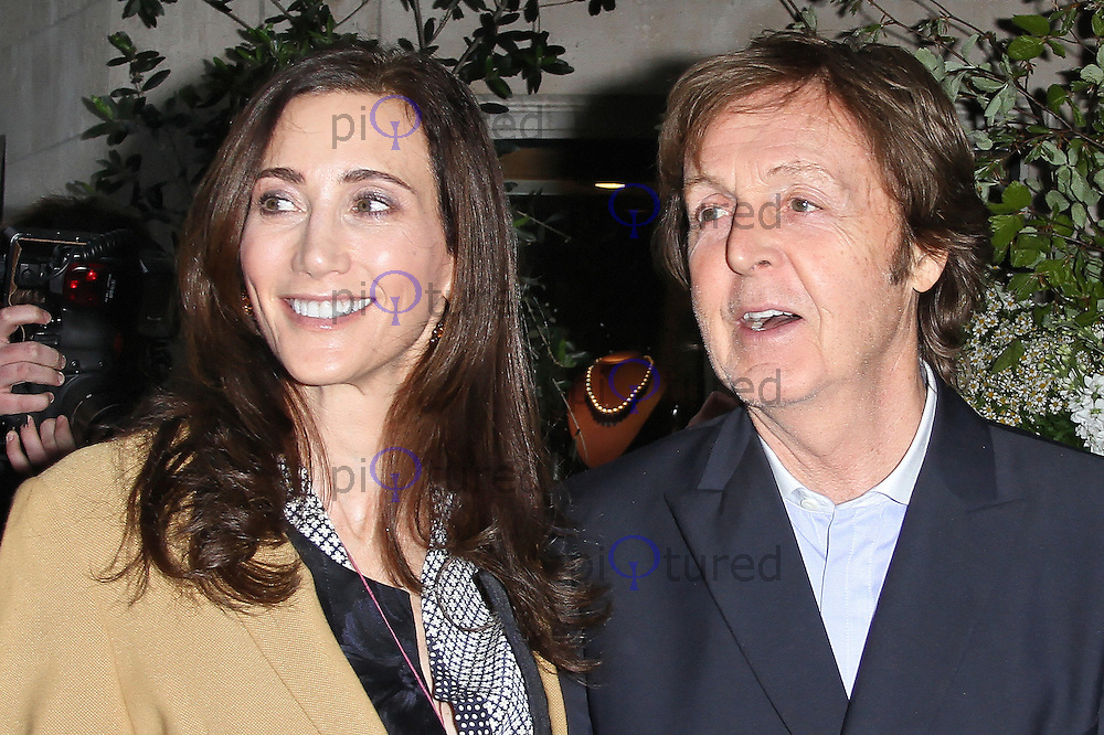 LONDON - MAY 03: Sir Paul McCartney; Nancy Shevell attend the launch party for Mary McCartney's new cookbook 'Food' at Liberty of London. May 03, 2012. (Photo by Richard Goldschmidt)