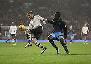 Fulham defender Tim Ream just beating Sheffield Wednesday striker Lucas Joao to the ball during the Sky Bet Championship match between Fulham and Sheffield Wednesday at Craven Cottage, London, England on 2 January 2016. Photo by Matthew Redman.