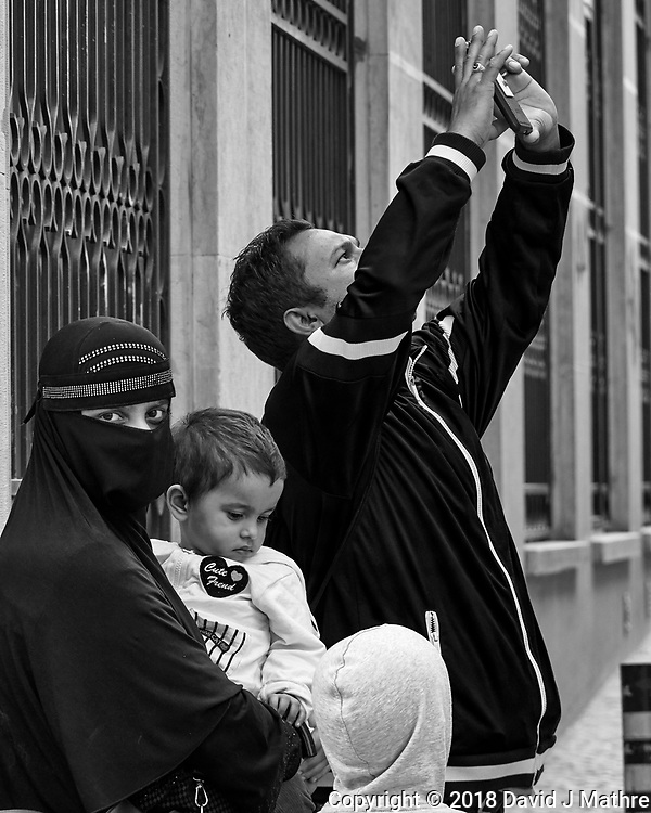 Snapshot from the Vanl. Afternoon Street Photography in Lisbon. Image taken with a Nikon 1V3 camera and 70-300 mm VR telephoto zoom lens.