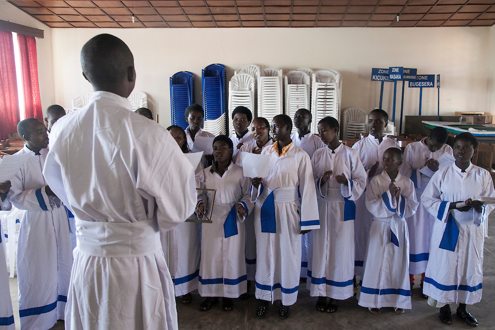 Choir members practice before mass at The Shrine of Our Lady of Sorrows in Kibeho, Rwanda. This is the only sanctioned Marian sanctuary in Africa. Kibeho's overseers and the Rwandan government hope this place will become a top tourism site. <br /> <br /> Photographed on Sunday, October 26, 2014.<br /> <br /> Photo by Laura Elizabeth Pohl