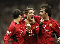 Photo. Aidan Ellis.<br /> Manchester United v Tottenham Hotspur.<br /> FA Barclaycard Premiership.<br /> 20/03/2004.<br /> United's Cristiano Ronaldo celebrates his goal with Ruud Van Nistelrooy and Ryan Giggs