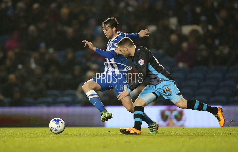 Brighton central midfielder, Dale Stephens (6) and Sheffield Wednesday striker Gary Hooper (14) during the Sky Bet Championship match between Brighton and Hove Albion and Sheffield Wednesday at the American Express Community Stadium, Brighton and Hove, England on 8 March 2016.