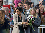 Meghan Duchess of Sussex with flowers from the crowd at the Joff Youth Centre, Peacehaven, East Sussex on 3 October 2018.