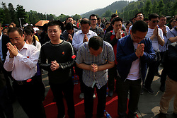 Chinese visitors pray to Mao Zedong's giant statue after offering flower wreaths on Mao Zedong Bronze Statue Square in Shaoshan, Hunan Province in central China, 28 April 2016. Shaoshan is the hometown of former Communist leader Mao Zedong, popularly known as Chairman Mao. Thousands of visitors descend on this small Chinese town burrowed in the hills of Central China's Hunan province to pay homage to the great helmsman everyday. It is one of the core sites of the 'Red Tourism' industry, where communist party cadres and ordinary Chinese tourists alike seek to relive the experiences and rekindle the spirit of the revolutionaries.