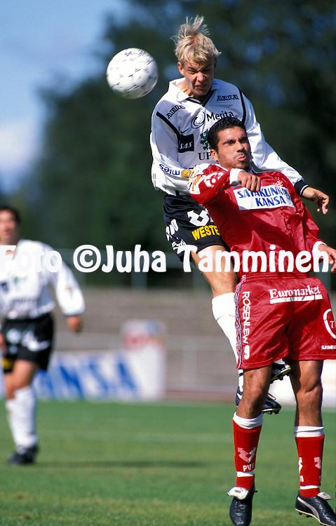 08.08.1999, Pori, Finland..Veikkausliiga / Finnish League.FC Jazz v FC Haka.Jukka Rantala (Haka) v Hasan Cetinkaya (Jazz).©JUHA TAMMINEN
