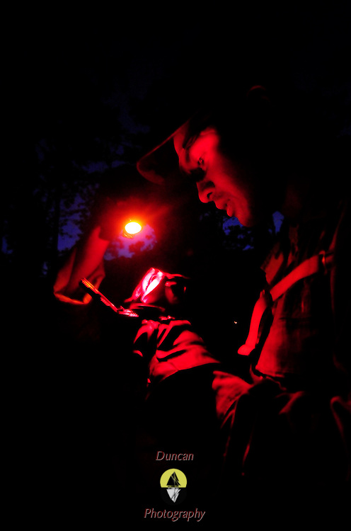 October 10, 2008 -- GULFPORT, Miss. U.S. Navy Master-at-Arms 2nd Class Lawrence Limson plots a point on a map at night as part of a land navigation course at Expeditionary Combat Skills School (ECS).  <br /> The ECS school is designed to build a basic level of battlefield competence for sailors from the Navy's newly formed Expeditionary Combat  Combat Command  (NECC) community. The students have a wide range of precision modern warfare skills. Because the Navy is supporting missions ashore more than ever, there is a significant need for sailors to gain land-based combat skills. The aim of the school is to provide NECC sailors basic warfighting and survival capabilities. Photo by Mass Communication Specialist 1st Class Roger S. Duncan.  (RELEASED)