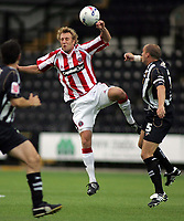 Photo: Paul Thomas.<br /> Notts County v Sheffield United. Pre Season Friendly. 01/08/2006.<br /> <br /> Rob Hulse wins the ball for Sheffield.