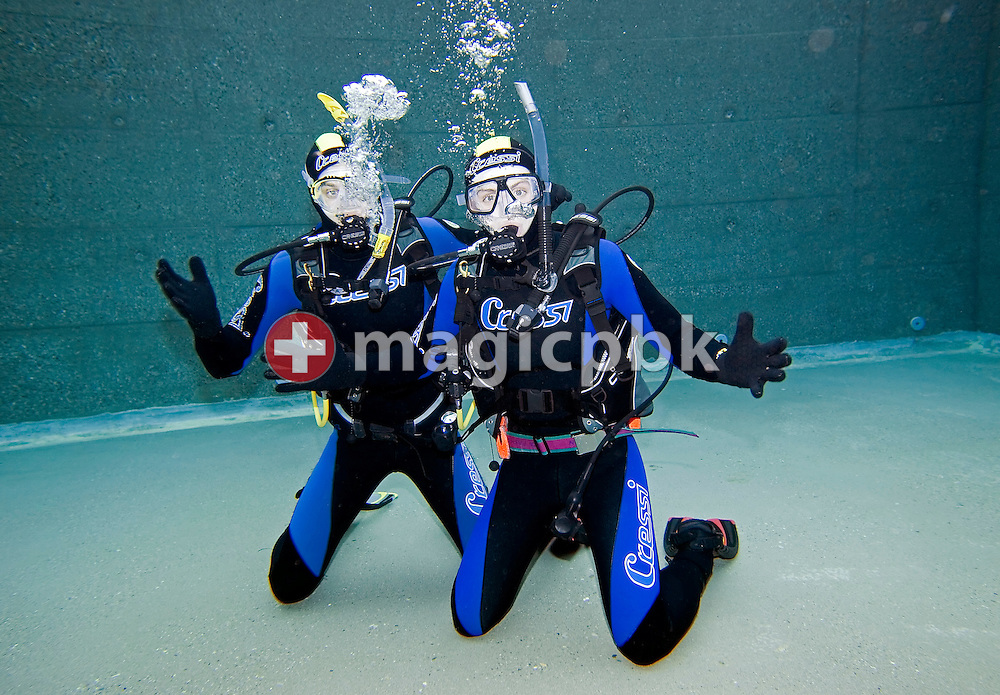 Diver Joel SPIRIG (L) and Olivier FORNARO (R) of Switzerland are posing during a PADI scuba diving training lesson in the outdoor pool in Gossau, ZH, Switzerland, Monday, May 26, 2008. (Photo by Patrick B. Kraemer / MAGICPBK)