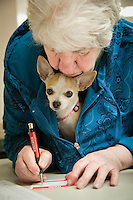 Mary Belton with her dog, Bella, at the Prospector's Society meeting, Anchorage