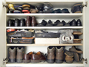 many shoes neatly placed in a cupboard