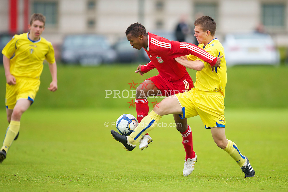 LIVERPOOL, ENGLAND - Thursday, April 29, 2010: Liverpool's Toni Brito De Silva in action against Leeds United's Lewis Turner during the FA Academy Under-18's League at the Academy. (Photo by David Rawcliffe/Propaganda)