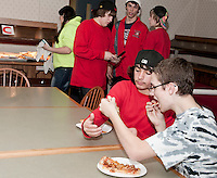 """Michael Cavette and Caelan Norwood try to determine the """"Best Pizza in Town"""" during NH JAG's 4th annual event held Thursday evening at Laconia High School.  (Karen Bobotas/for the Laconia Daily Sun)"""