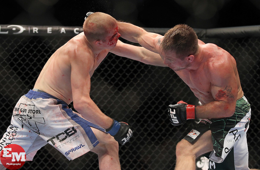 September 25, 2010; Indianapolis, IN; USA; Evan Dunham (white trunks) and Sean Sherk (green trunks) during their bout at UFC 119 at the Conseco Fieldhouse in Indianapolis, IN. Sherk won via split decision.