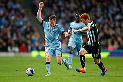 James Milner of Manchester City is challenged by Jack Colback of Newcastle United - Photo mandatory by-line: Rogan Thomson/JMP - 07966 386802 - 29/10/2014 - SPORT - FOOTBALL - Manchester, England - Etihad Stadium - Manchester City v Newcastle United - Capital One Cup Fourth Round.