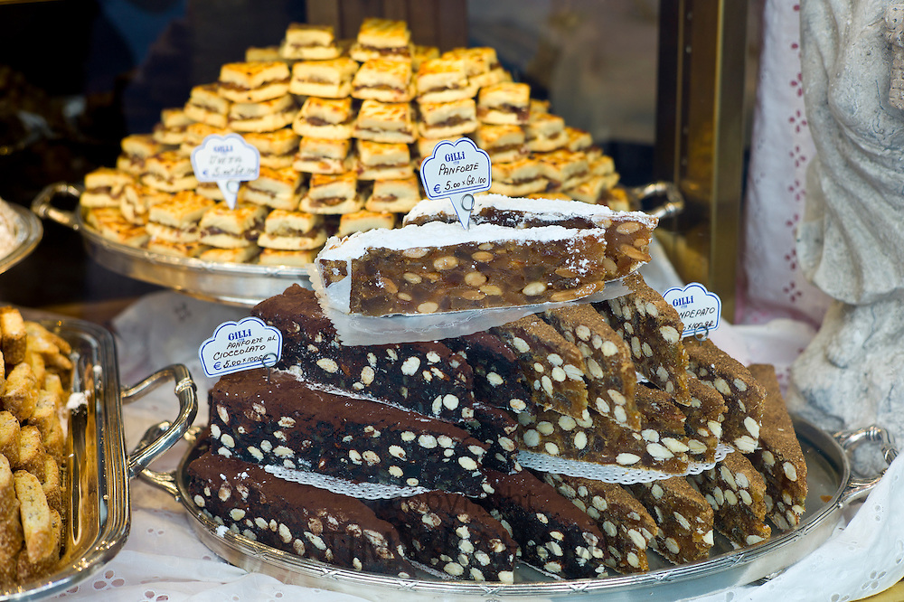 Panforte cakes and pastries in shop window of luxury patticeria, caffe Gilli, established in 1733 in Florence, Tuscany, Italy