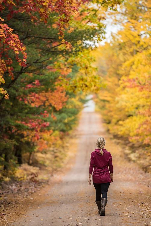 Walking down a fall color tunnel of trees near Big Bay, Michigan.