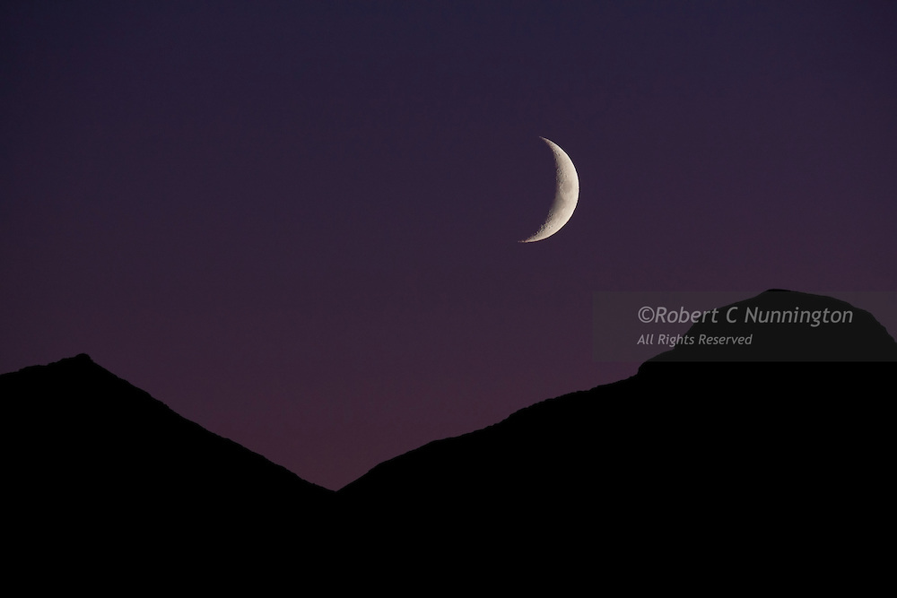 A waxing crescent moon over the St. Mary area of Glacier National Park.
