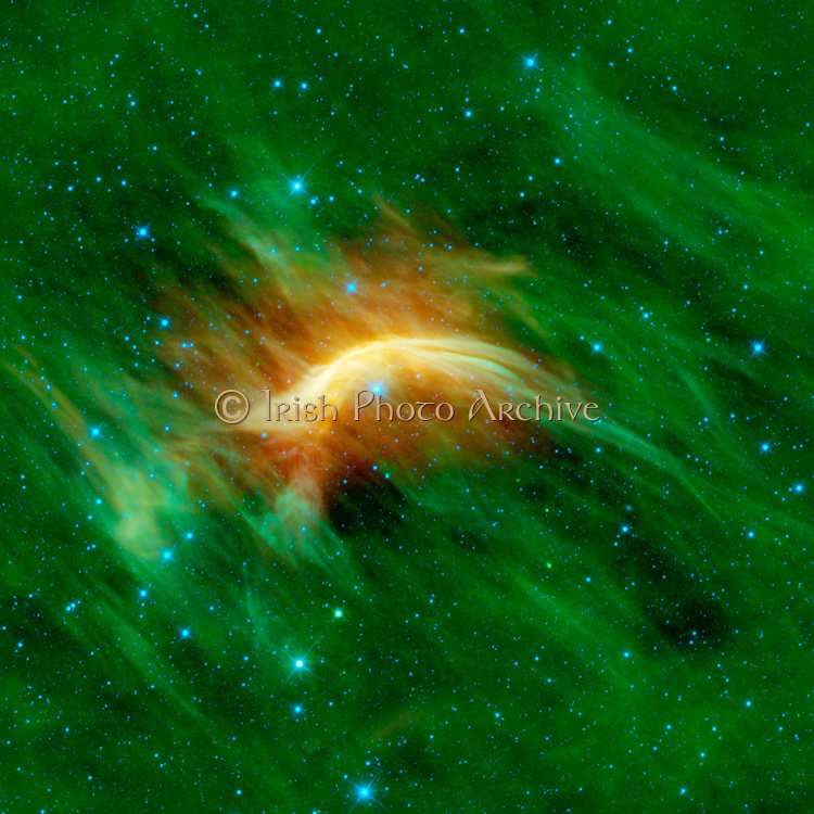 The blue star near the center of this image is Zeta Ophiuchi. Zeta Ophiuchi is actually a very massive, hot, bright blue star plowing its way through a large cloud of interstellar dust and gas. WISE.