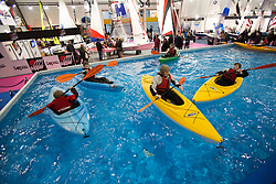 © licensed to London News Pictures. London, UK 12/01/2013. People and children canoeing in London Boat Show at ExCeL London. Visitors have the opportunity to see thousands of boats, brands, products and suppliers by over 500 exhibitors. Photo credit: Tolga Akmen/LNP