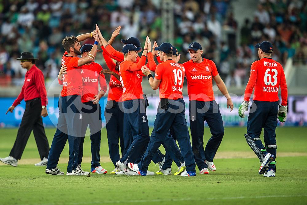 England celebrate the wicket of Shoaib Malik of Pakistan during the 2nd International T20 Series match between Pakistan and England at Dubai International Cricket Stadium, Dubai, UAE on 27 November 2015. Photo by Grant Winter.