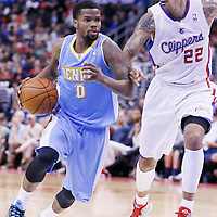 15 April 2014: Denver Nuggets guard Aaron Brooks (0) drives past Los Angeles Clippers forward Matt Barnes (22) during the Los Angeles Clippers 117-105 victory over the Denver Nuggets at the Staples Center, Los Angeles, California, USA.