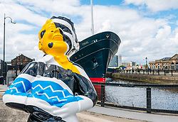 Pictured: Oor Wullie Bucket Art Trail. Leith, Edinburgh, Scotland, United Kingdom, 17 June 2019. An art trail of 200 Oor Wullie sculptures have appeared in Scottish cities overnight in a mass arts event that lasts until August 30th. The sculptures will be auctioned to raise money for Scotland's children's hospital charities. There are 5 in the Leith area, and 60 in Edinburgh altogether. Bobby Dazzler by Scott Dawson and Rachel Miller next to Fingal Edinburgh in Leith Docks.<br /> <br /> <br /> Sally Anderson | EdinburghElitemedia.co.uk