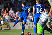 MJ Williams shoots during the EFL Sky Bet League 1 match between Rochdale and Walsall at Spotland, Rochdale, England on 25 August 2018.