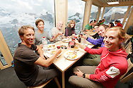 """Swiss, British teams at the Hornli hut with view of Breithorn and Monte Rosa massif, on the eve of the 150th ascension of Matterhorn, marking the second date of 150th anniversary.<br /> <br /> """"Matterhorn 150 years Cervino"""" - The year 2015 is the 150th Anniversary of the first ascent by Edward Whymper from the Swiss side (14th July) and by Jean Antoine Carrel from the Italian side on the 17th July 1865.<br /> On 17th July 2015 a friendship convention was signed by the members of Swiss, French, British and Italian climbing teams. A ceremony was held at the summit in honour of the mountain."""