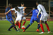 England U18 forward Elliot Embleton (11) tries to get through a crowded French defence during the U18 International match between England and France at London Road (ABAX Stadium), Peterborough, England on 14 November 2016. Photo by Nigel Cole.