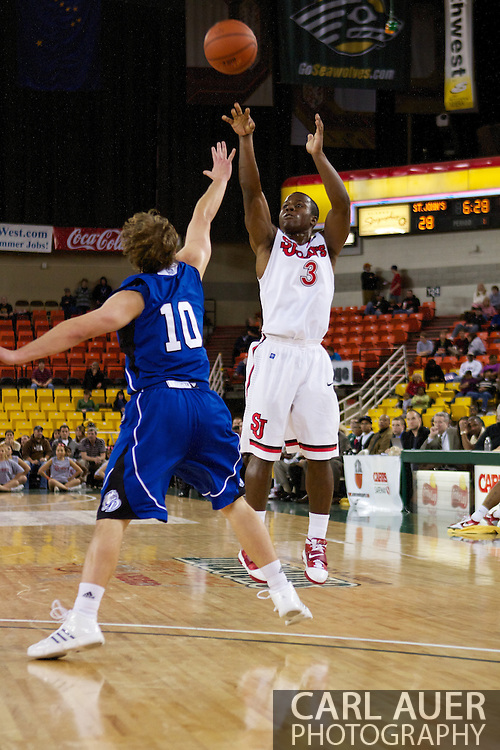 November 26th, 2010:  Anchorage, Alaska - St. John's senior guard Malik Boothe (3) attempts a three point shot in the Red Storm's semi final game of the Great Alaska Shootout against the Drake Bulldogs.  The Red Storm defense held Drake to a tournament low score as St. Johns advanced to the final game 82-39.