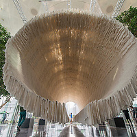 Zhu Jinshi's 'Boat' Installation art at The Rotunda, Exchange Square on March 9, 2015 in Central, Hong Kong. The public exhibition brings to Hong Kong for the first time a monumental 18-metre long, 7-metre high installation, Boat by Zhu Jinshi, composed of bamboo, cotton and over 12,000 sheets of xuan (rice) paper. Zhu Jinshi is one of China's leading contemporary artists who has offered outstanding contributions to the field across various mediums, including painting, performance art and art installation. Photo by Xaume Olleros / studioEAST