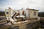 CAGUAS, PUERTO RICO - OCTOBER 10, 2017 -  A destoyed home on road PR-172 in Caguas, Puerto Rico, where the center of Hurricane Maria vered west and caused some of the most extensive damage. The owner Milagros left the island on October 5th to treat her sons medical condition. (Photo/Jos&eacute; Jim&eacute;nez) Through the Iris of Hurricane Mar&iacute;a<br />