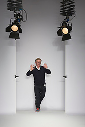 © Licensed to London News Pictures. 15 February 2014, London, England, UK. English fashion designer Jasper Conran at the end of his runway at during London Fashion Week AW14 at the Saatchi Gallery off King's Road, London. Photo credit: Bettina Strenske/LNP