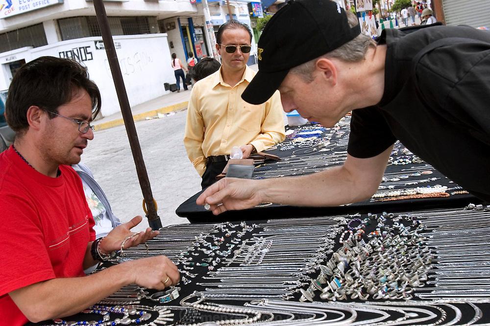 David Griffin shops at the outdoor market at Otavalo, Ecuador.
