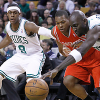 06 March 2012: Boston Celtics point guard Rajon Rondo (9) watches Houston Rockets point guard Kyle Lowry (7) vies for the loose ball with Boston Celtics power forward Kevin Garnett (5) during the Boston Celtics 97-92 (OT) victory over the Houston Rockets at the TD Garden, Boston, Massachusetts, USA.