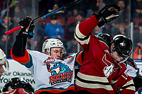 KELOWNA, BC - FEBRUARY 15: Kyle Topping #24 of the Kelowna Rockets checks Jayden Grubbe #9 of the Red Deer Rebels at Prospera Place on February 15, 2020 in Kelowna, Canada. (Photo by Marissa Baecker/Shoot the Breeze)