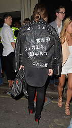Chloe Green wearing a leather stuuded jacket with the words 'East End Girls Don't Care' printed on the back at the Chinawhites club in London, UK. 03/05/2014<br />